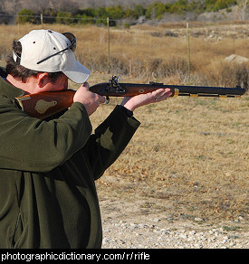 Photo of a man aiming a rifle.