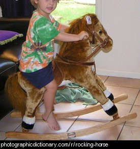 Photo of a child on a rocking horse