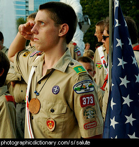 Photo of a boy scout saluting