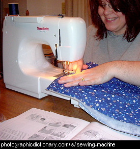 Photo of a woman using a sewing machine