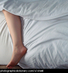 Photo of white sheets on a bed.