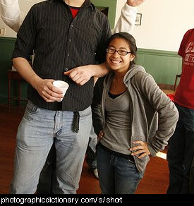 Photo of a short woman next to a tall man