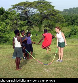 Photo of some African children playing jump rope