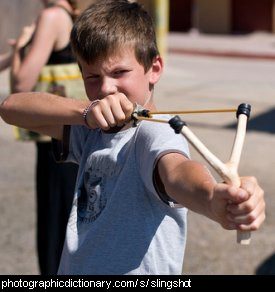 Photo of a boy using a slingshot