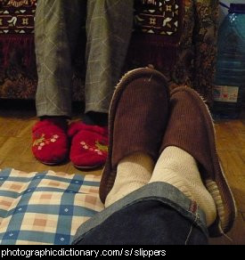 Photo of feet wearing slippers.