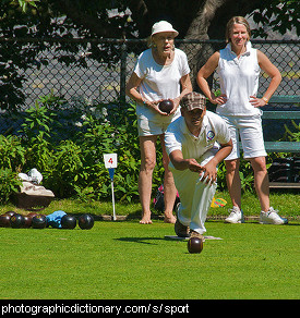 Photo of people playing lawn bowls