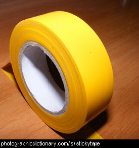 Photo of yellow stickytape.