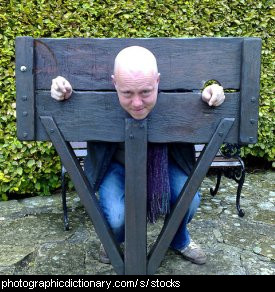 Photo of a man in stocks