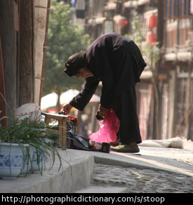 Photo of an old woman stooping