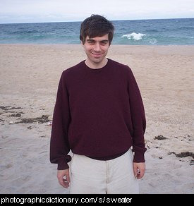 Photo of a man wearing a sweater.