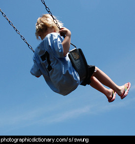Photo of a girl swinging