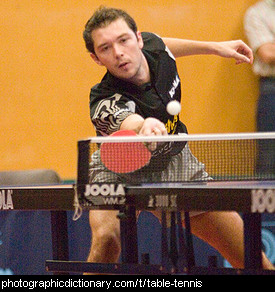Photo of a man playing table tennis