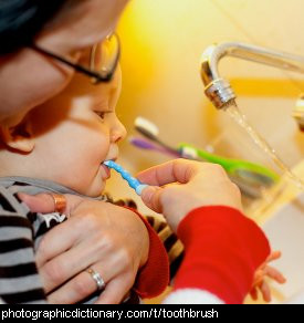 Photo of a child using a toothbrush