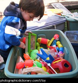 Photo of a child with a box of toys