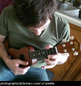 Photo of a man playing a ukelele