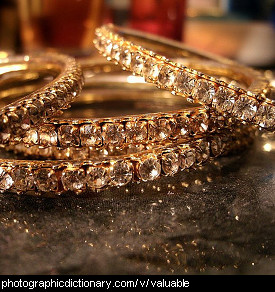 Photo of some gold and diamond bangles