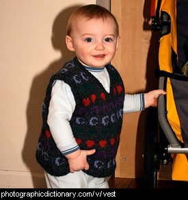 Photo of a baby wearing a vest
