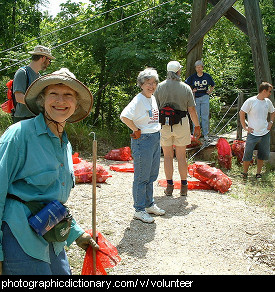 Photo of volunteers picking up rubbish.