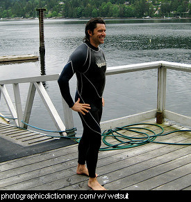 Photo of a man wearing a wetsuit.