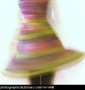 Photo of a woman whirling around