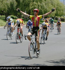 Photo of a cyclist winning a race