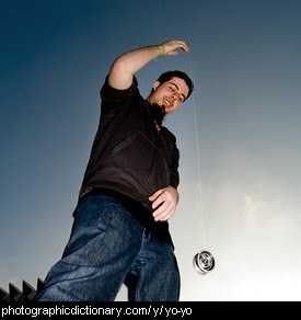 photo of a man playing with a yoyo